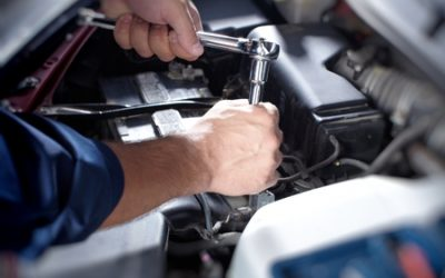 35721686 - mechanic working in auto repair garage